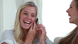 Happy woman using a cellphone together Footage