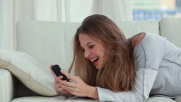 Happy woman typing on her cellphone Stock Video Footage