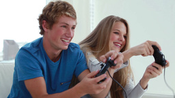 Happy couple playing video games together Footage