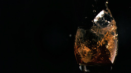 Ice cubes falling in super slow motion Footage