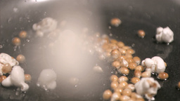 Popcorn cooking in super slow motion Stock Video Footage