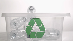 Plastic bottles falling in super slow motion into  Footage