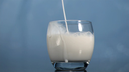 Milk filling a glass in super slow motion Stock Video Footage