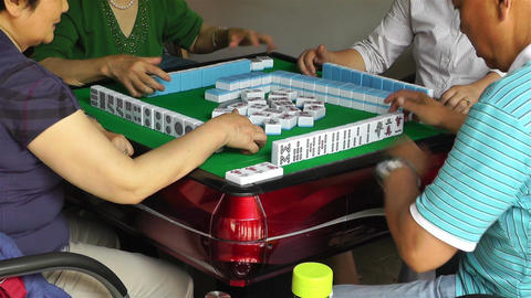 Playing Mahjong in China handheld Footage