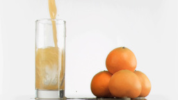 Fresh orange juice poured in super slow motion Stock Video Footage