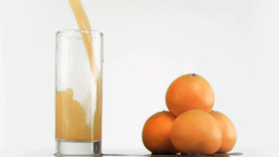 Fresh orange juice poured in super slow motion Footage