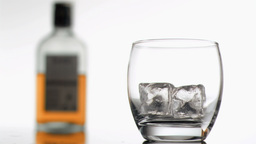 Whiskey being poured in super slow motion in a gla Stock Video Footage