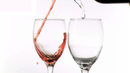 Wine and water poured in super slow motion Footage