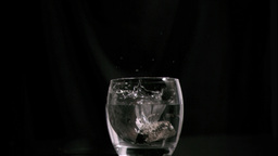 Coal burning in super slow motion in a glass Stock Video Footage
