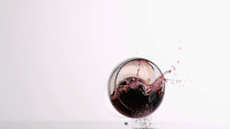 Glass of red wine falling in super slow motion Footage