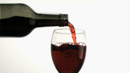 Red wine poured in super slow motion Footage