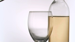 Bottle pouring in super slow motion white wine Stock Video Footage