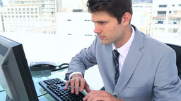 Man in suit typing on a keyboard Stock Video Footage