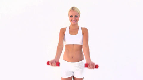 Woman using dumbbells Footage