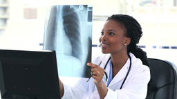 Female doctor looking at a chest Xray Footage