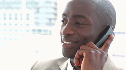 Black businessman smiling on the phone Footage