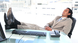 Latin businessman resting in his office Stock Video Footage