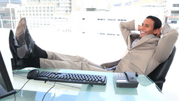 Latin businessman resting in his office Footage