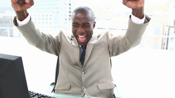 Black businessman shouting and raising arms Live Action