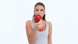 Woman eating a red apple Footage