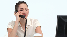 Female worker on the phone at her desk Stock Video Footage