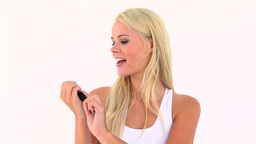 Blonde filing her nails Stock Video Footage