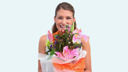 Woman Smelling A Flower Bouquet stock footage