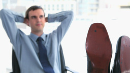 Businessman with his feet on his desk Stock Video Footage