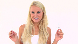 Happy blonde holding a syringe Footage