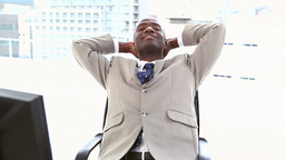 Black businessman resting on his chair Footage