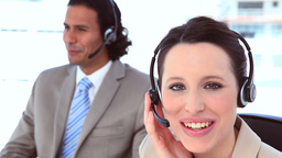 Smiling people in suit using headsets Stock Video Footage