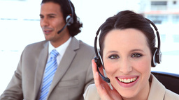 Smiling people in suit using headsets Footage