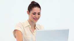 Smiling young worker on a laptop Stock Video Footage