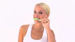 Blonde using a toothbrush Stock Video Footage