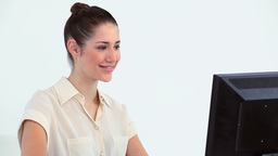 Young woman working on a computer Footage