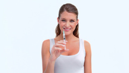 Smiling woman holding a syringe Stock Video Footage