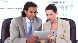 Business people using a digital tablet Footage
