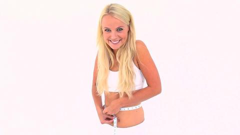 Blonde woman measuring her waist Footage