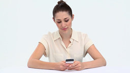 Young woman texting at a desk Footage