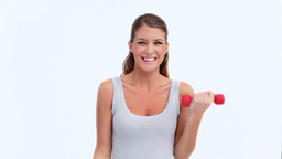 Smiling woman using red dumbbells Footage