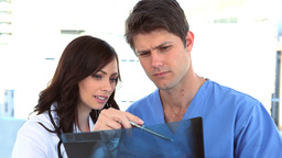 Two doctors examining an xray Stock Video Footage