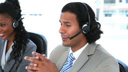 Business people speaking while wearing headset Stock Video Footage