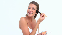 Happy woman putting blush on her face Footage