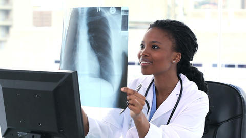 Female doctor examining a chest Xray Footage