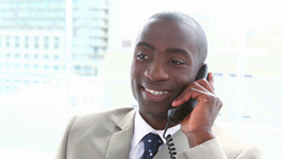 Smiling black businessman on the phone Stock Video Footage