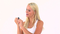 Blonde using a nail file Stock Video Footage