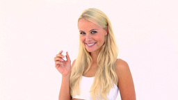 Happy blonde using a lips balm Stock Video Footage