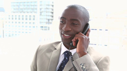 Smiling businessman phoning Footage