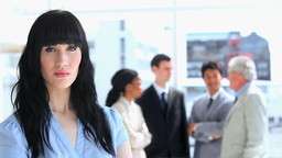 Businesswoman standing in front of her work team Stock Video Footage