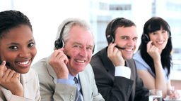 Happy business people working with headsets Footage